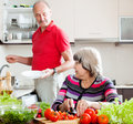 Elderly man and mature woman doing housework men women together Stock Image