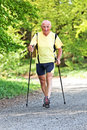 Elderly man with Nordic walking Stock Photo