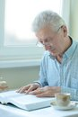 Elderly man is resting at home after heavy everyday Stock Photography
