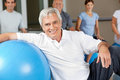 Elderly man sitting next to gym Royalty Free Stock Photography