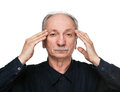 Elderly man suffering from headache Stock Images
