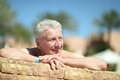 Elderly man sunbath cute at resort vacation Stock Photo