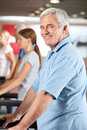 Elderly man on treadmill in gym Stock Photos