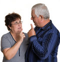 Elderly man and woman arguing. Royalty Free Stock Photos