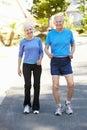 Elderly man and younger woman jogging men women Stock Photo
