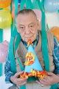 Elderly mans birthday party Royalty Free Stock Image