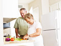 Elderly married couple cooking dinner photo of an Stock Image