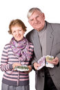 Elderly married couple with money in hands Royalty Free Stock Photos