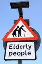 Elderly people crossing sign. Royalty Free Stock Photo