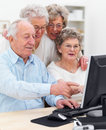 Elderly people working together on computer Royalty Free Stock Photography