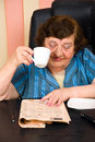 Elderly reading news and drink cup of coffee Royalty Free Stock Images