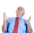 Elderly senior man with white hair looking upwards and praying and asking for a miracle closeup portrait of an isolated on Stock Photography
