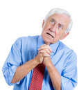 Elderly senior man with white hair looking upwards and praying and asking for a miracle closeup portrait of an isolated on Royalty Free Stock Photography