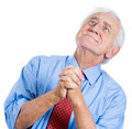 Elderly senior man with white hair looking upwards and praying and asking for a miracle closeup portrait of an isolated on Stock Photo