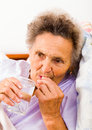Elderly taking pills lady with alzheimer s disease Royalty Free Stock Image