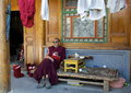 Elderly tibetan monk relaxing in ta er monastery Stock Photos