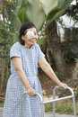 Elderly use eye shield covering after cataract surgery in backyard Royalty Free Stock Photography