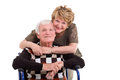 Elderly wife handicapped husband supportive hugging isolated on white Stock Images