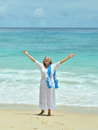 Elderly woman  on beach Royalty Free Stock Photo