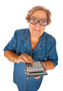 Elderly woman with calculator Royalty Free Stock Images