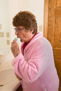 Elderly Woman COPD Medical Inhaler Royalty Free Stock Photo