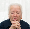 Elderly woman coughing on a white background Royalty Free Stock Image