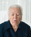 Elderly woman coughing on a white background Stock Photo