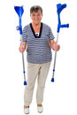 Elderly woman with crutches senior isolated on white Royalty Free Stock Image