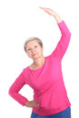 Elderly woman doing side bends cheerful gymnastic exercises vigorously Royalty Free Stock Photography