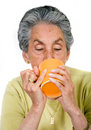 Elderly woman drinking a hot drink Royalty Free Stock Photos
