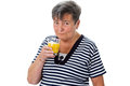 Elderly woman drinking orange juice senior isolated Royalty Free Stock Images