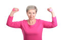 Elderly woman with dumbbells cheerful doing gymnastic exercises vigorously Royalty Free Stock Images
