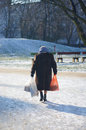 Elderly woman eldery with shopping bags in the winter Royalty Free Stock Photography