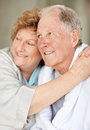 An elderly woman embracing a senior man Royalty Free Stock Image