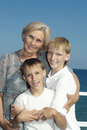 Elderly woman with grandchildren portrait of an women two on a summer holiday Royalty Free Stock Images