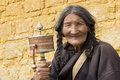Elderly woman holding prayer wheel Royalty Free Stock Photo
