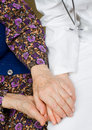 Elderly woman holds the doctor's hands Royalty Free Stock Photo