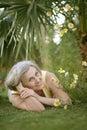 Elderly woman lying at resort o grass Stock Photography