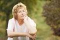 Elderly woman near a wicket to the garden Stock Photo