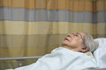 Elderly woman plus year old in a hospital bed Royalty Free Stock Photos