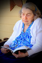 Elderly Woman Reading Bible Royalty Free Stock Photo