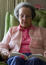 Elderly Woman Reading Her Bible Stock Photos