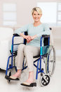 Elderly woman sitting wheelchair happy on at home Royalty Free Stock Photo