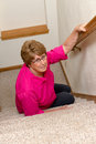 Elderly woman slip fall home accident an old mature senior has had a and on a stairway the stairs are a mobility issue and she Royalty Free Stock Photos