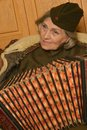 Elderly woman solder playing accordion cute closeup Stock Photo