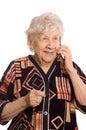 The elderly woman speaks on the phone