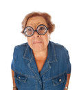 Elderly woman surprised with funny glasses on white Royalty Free Stock Photography
