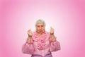 Elderly woman in suspense and determination