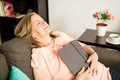 Elderly woman taking a nap at home Royalty Free Stock Photo