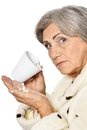 Elderly woman taking pills sick senior isolated on white Stock Photos